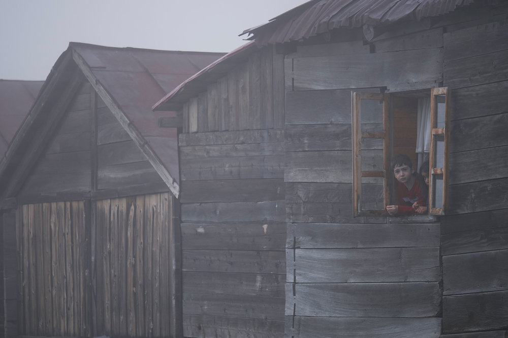 Bakhmaro-Georgia-boy-in-a-wooden-house