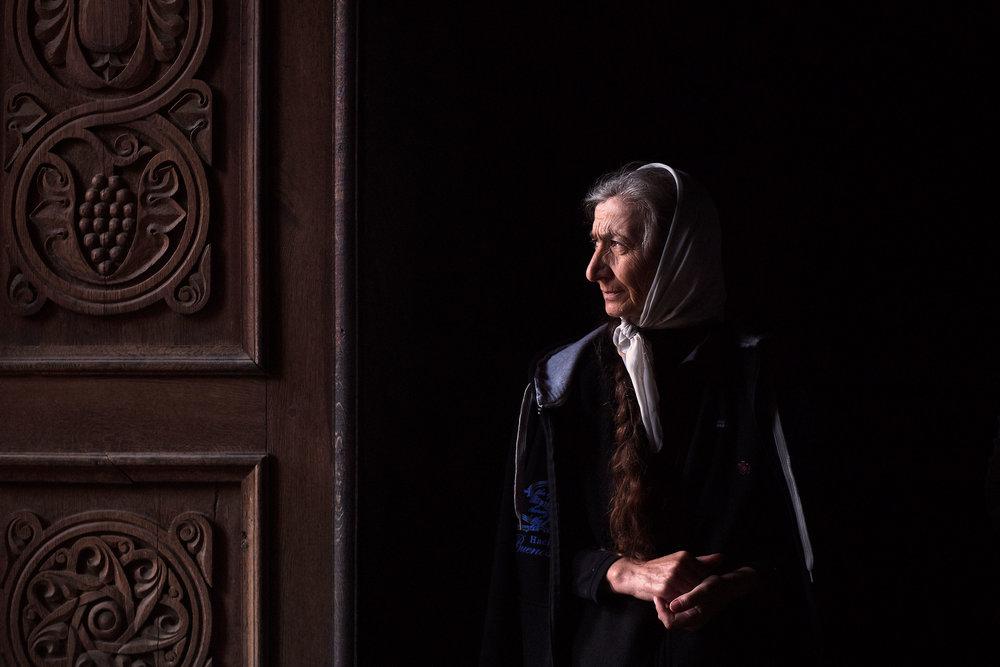 Armenia,-Tatev-monastery-woman-by-the-church-door