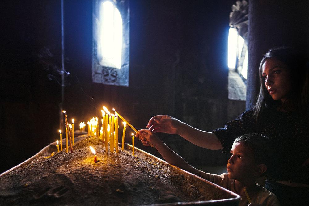 Armenia-Geghard-lighting-candle