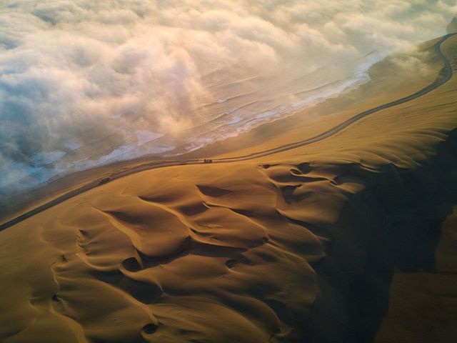 On my 1,200km journey down the coast of Peru I've realised that this is a land of epic scenery. This evening – sand dunes, the Pacific ocean, and fog. The setting sun painted everything gold. Couldn't have dreamt it up.  #Mavic #Peru #aerial #drone #pacificocean #fog #sunset #desert #beautifulworld #lonelyplanet #dusk #goldenhour #traveltheworld #instatravel #travelling #arountheworld #traveler #travelgram #wanderlust #adventure #view #travelphotography #dunes