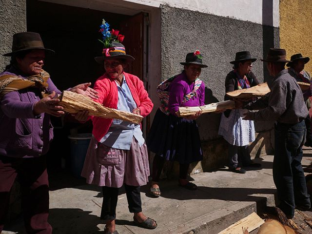 Quechua villagers passing chopped wood to a storage area. The wood will be used for a fire in a major religious celebration in a couple of months.  #travel #peru #Quechua #culture #ceremony #gx80 #Lumix #Panasonic #everydaylife #travelphotography #lonelyplanet #Ayacucho #Andes