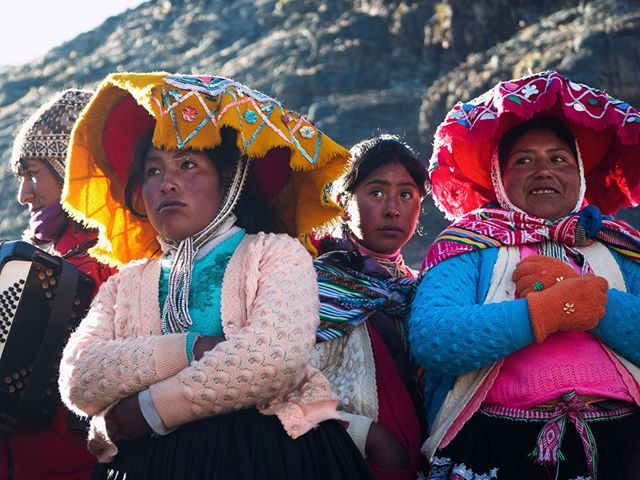 Quechua women watch dances at a chapel at Q'oyoriti celebration in the Peruvian Andes.  #Qoyoriti #Peru #Andes #Quechua #Queshua #celebration #portrait #travelportrait #travelphotography #travelphotographer #faces #Inca #women #colorful #culture #Panasonic #G9 #Lumix