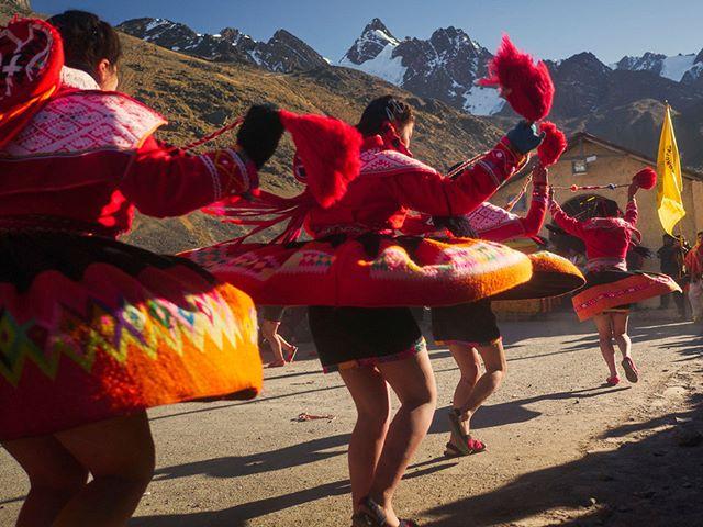 Dancers in front of a chapel at Q'oyoriti celebration.  #Qoyoriti #Peru #Andes #Queshua #celebration #dance #tradition #travelphotography #travelphotographer #movement #Inca #women #colorful #culture #Panasonic #Gx80 #Lumix