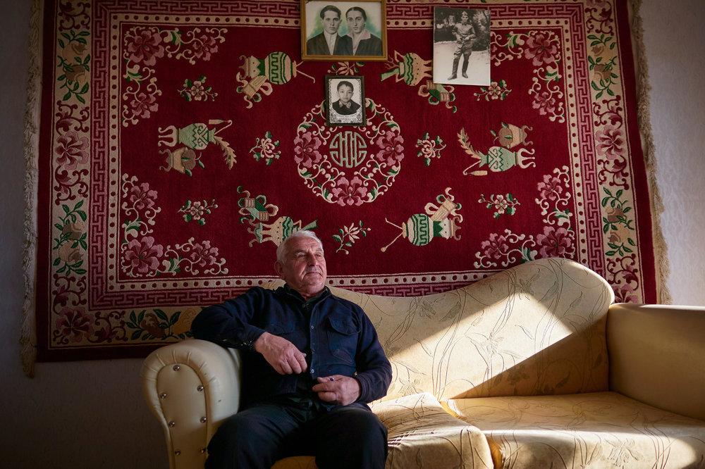 Tskaltubo elderly man Vakhtang in his room.jpg