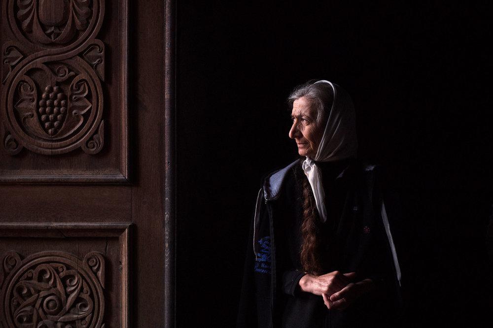 Armenia,-Tatev-monastery-woman-by-the-church-door.jpeg