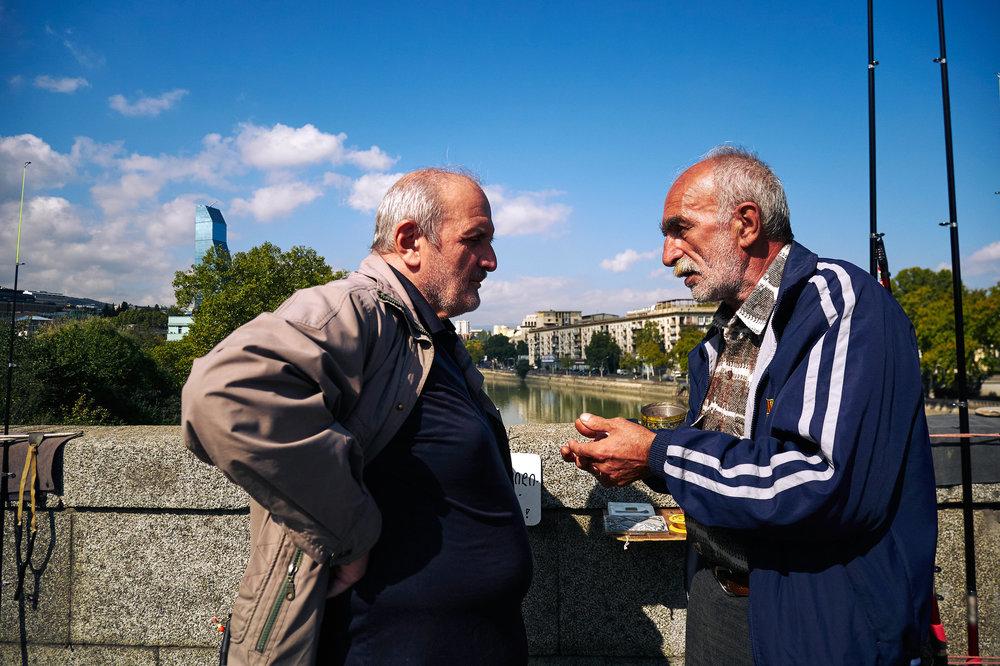 Men chatting on a bridge in Tbilisi, Georgia.jpeg