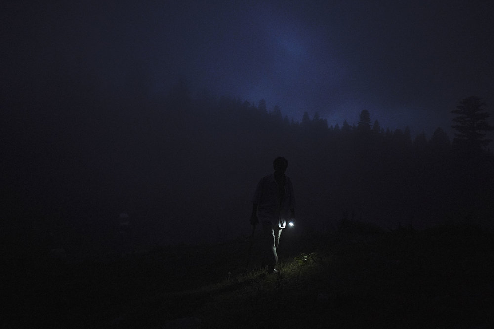 Tamaz the shepderd with a torch in the darkness in High Adjaria.JPG