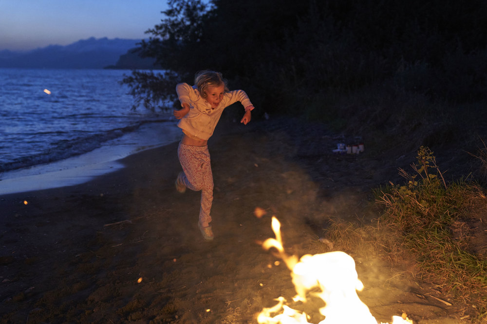 Mia dancing by the fire next to Lake Sevan.JPG