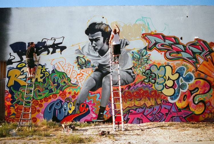 On left is QUAKE of MSG working on his piece for the REEFA memorial wall in Wynwood. Pictured in the middle is ERAZE.