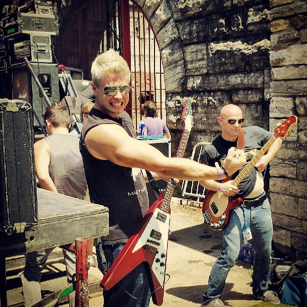 These two #dudes , @frankievictory & @erictuv , clowning around #backstage. #bunburyfestival #beefree #amphitheater #stage #summer #musicians #guitarist #Gibson #flyingv #shades #aviators #ErnieBall #bassist #thesummerofcutoffs #sleeveless #Metallica #Marshall #mesaboogie #amps #halfstack #bands #Cincinnati #ohio #cincymusic #rock #pop #wallstreet #theupsetvictory
