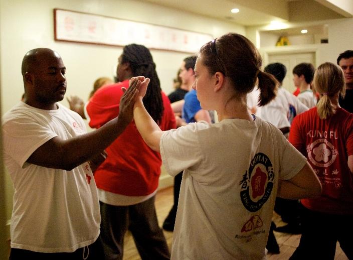 Students playing the Ving Tsun (wing chun) Kung Fu Pak Sao exercise at the Richmond Moy Yat Kung Fu Academy.