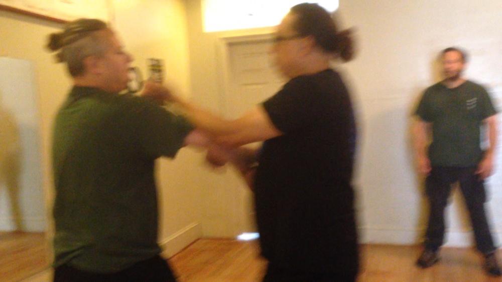 Grandmaster Moy Tung does Lop Sao on Sifu Stuart Zeno of the Main Street school