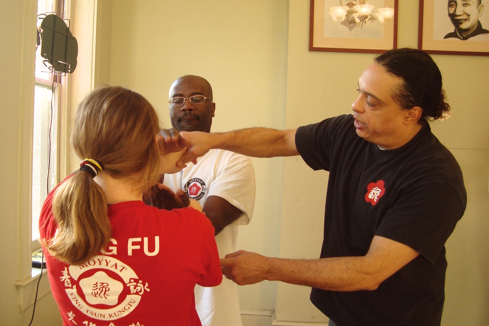 Grandmaster Anthony Moy Tung, founder of the Richmond Moy Yat Kung Fu Academy, teaching Ving Tsun Kung Fu's Luk Sao martial arts exercise for self-defense.