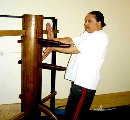 Grandmaster Moy Tung applying the Po Pai technique on the Ving Tsun (wing chun) Kung Fu Muk Yan Jong