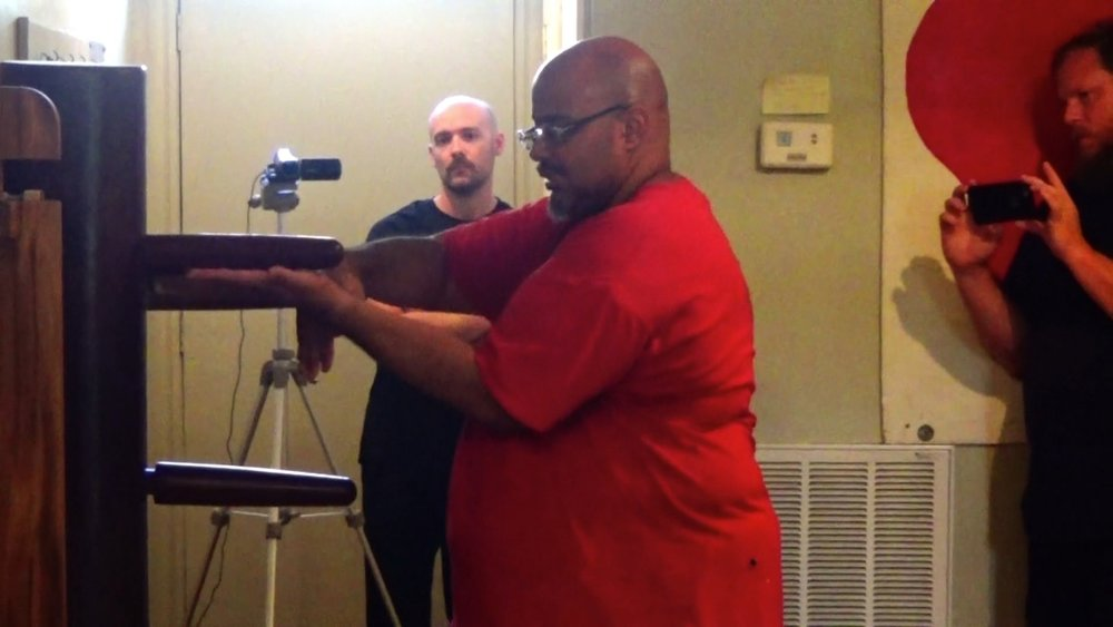 Sifu Richard 'Moy 52' Andino demonstrating Guan Sao/Tok Sao on the Ving Tsun (wing chun) Kung Fu Muk Yan Jong at the Richmond Moy Yat Kung Fu Academy's August 2016 Jong workshop