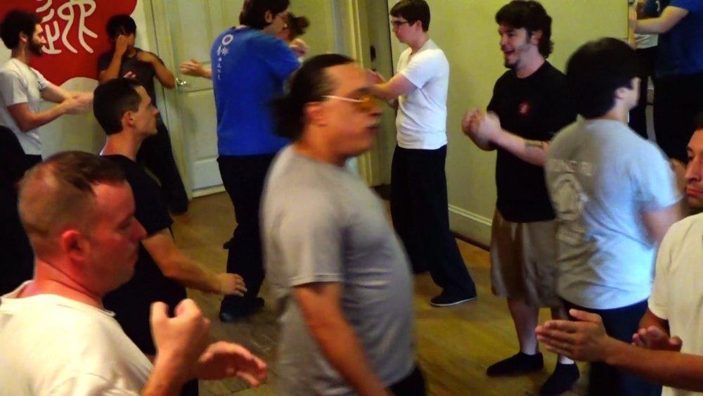 Grandmaster Anthony Moy Tung observing Ving Tsun (wing chun) Kung Fu training at the Richmond Moy Yat Kung Fu Academy Aug 2016 Jong workshop