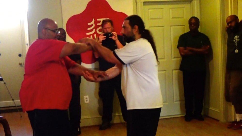 Sifu Richard 'Moy 52' Andino demonstrating Ving Tsun (wing chun) Chi Sao at the Richmond Moy Yat Kung Fu Academy Aug 2016 Jong workshop