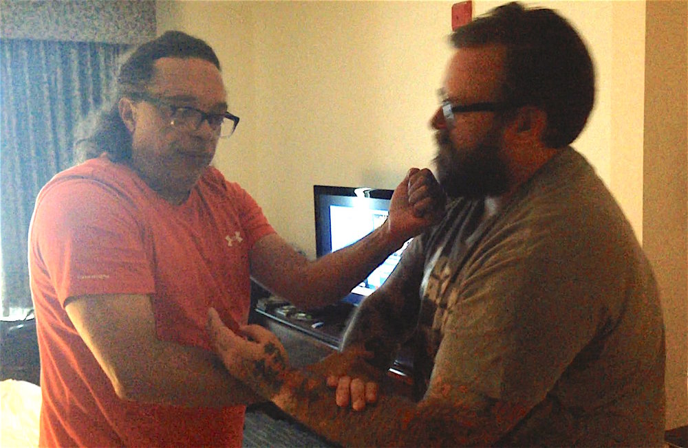 Grandmaster Moy Tung traps Austin Sifu Aaron Vyvial's hands with a Fuk Sao, while striking.