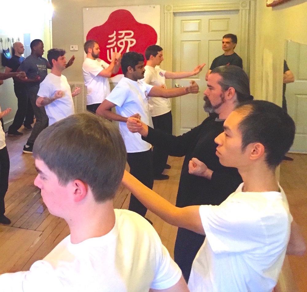 Students playing Siu Nim Tao, the foundational Ving Tsun (wing chun) Kung Fu form, at the Richmond Moy Yat Kung Fu Academy