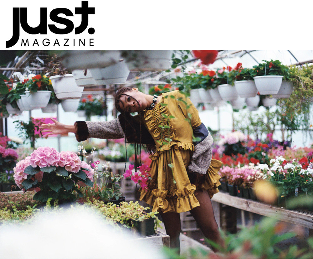 Just Magazine fashion editorial feature Kelsey Randall gold yellow marigold silk moire ruffle front full skirt swing skater dress long sleeve natural hair dreadlocks beauty floral flowers atrium flower shop nursery garden secret made-to-measure luxury bespoke custom made in New York City NYC Brooklyn Bushwick ethical sustainable diverse  Photographer  Franey Miller @franeymiller  Stylist  Kelsey Olivia @unit65  Makeup  Sophie Haig @sophiehaig  Models:  Karmay @ NoMad Agency & Adreena @ Fenton Moon