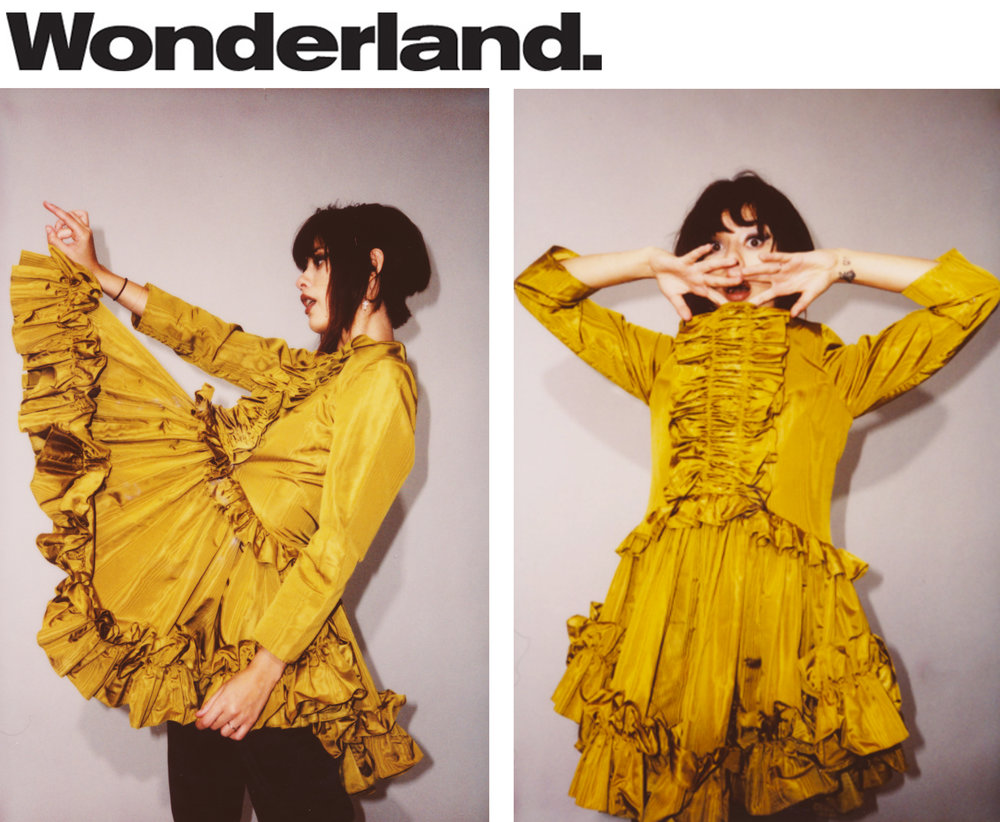 Wonderland Magazine fashion editorial feature polaroid land camera film Kelsey Randall gold yellow marigold silk moire ruffle front hem babydoll skater swing long sleeve dress full skirt made-to-measure luxury bespoke womenswear made in New York City NYC Brooklyn Bushwick handcrafted emerging designer sustainable ethical   Photography     Emily Soto  Fashion     Leo Max at Art Department  Hair and Makeup     Aliana Lopez at The Only Agency  Model     Alissa Salls at The Lions