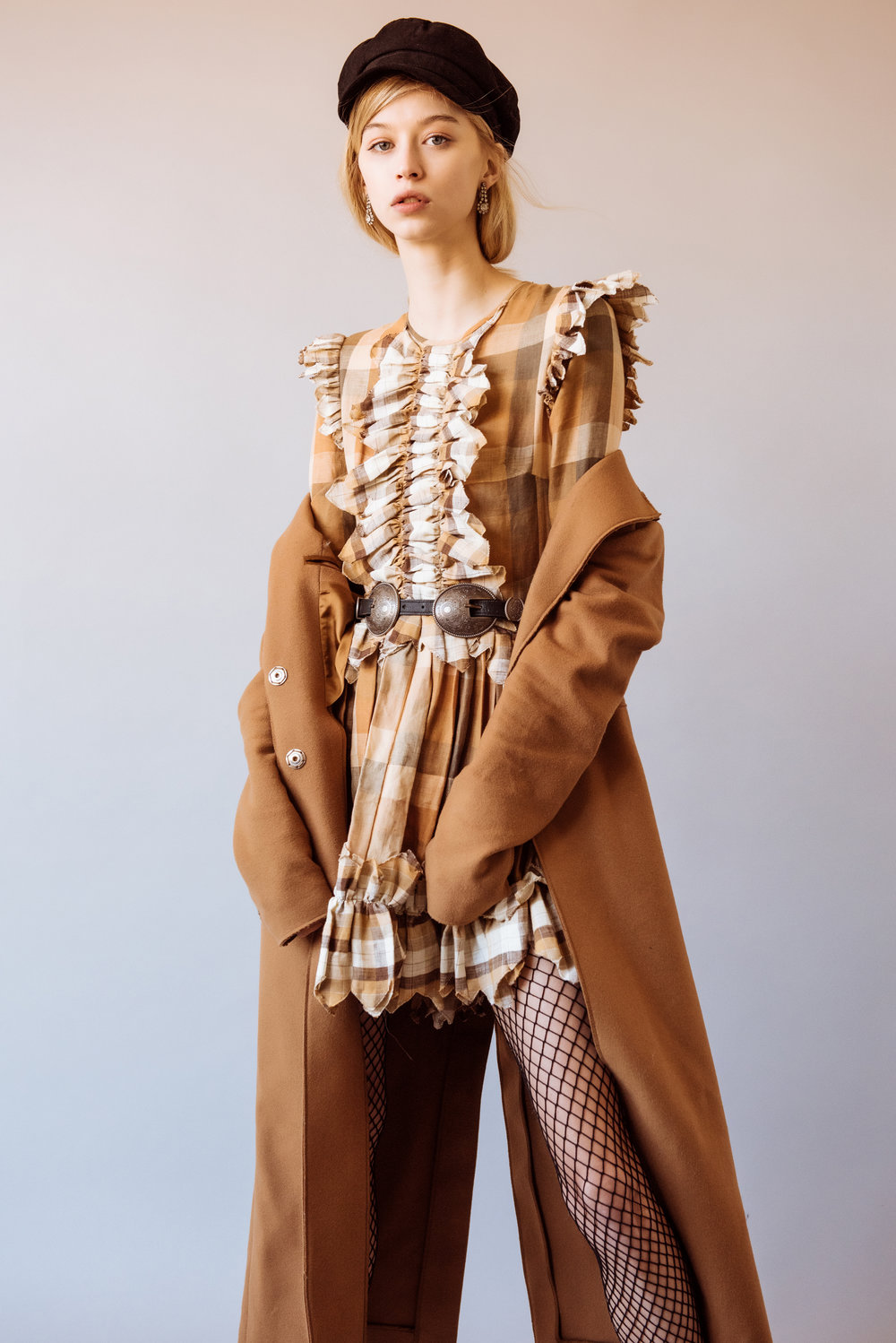 Tiffany Nicholson shoots Kelsey Randall plaid linen copper brown cream zig zag ruffle front long sleeve circle skirt dress camel mohair coat beret