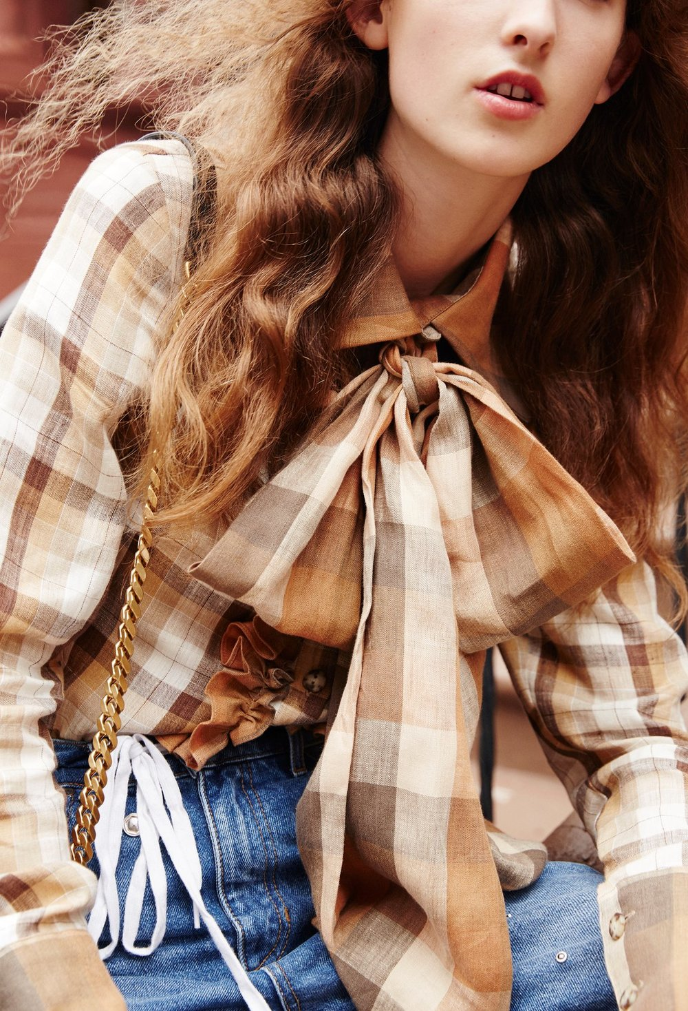 The Guardian sunday fashion editorial featuring Kelsey Randall plaid linen cream copper camel brown ruffle front big bow neck tie high wide collar blouse