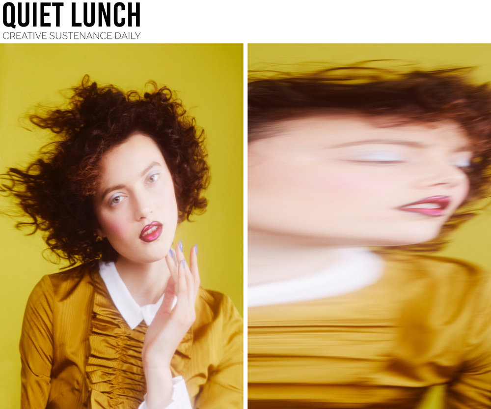 Quiet Lunch fashion editorial featuring Kelsey Randall gold silk moire ruffle front long sleeve babydoll dress white collar curly hair made-to-measure luxury bespoke custom designer womenswear made in New York City BrooklynNYC Bushwick handcrafted ethical sustainable ones to watch emerging designer star on the rise new talent unique local production Photographer: Eric T White |  @mrwhite_   | Agent: See Management Model: Matilda Lowther |  @matildalowther  | Agent: Heroes New York Stylist: Calvy Click |  @calvy.click  Makeup Artist: Georgina Billington |  @georginabillington  | Agent: Judy Casey Inc, using MAC Cosmetics. Hair Stylist: Ayumi Yamamoto |   @ayumi_yamamoto.hair  | Agent: Defacto Inc, using Christophe Robin Paris Manicurist: Yuko Wada  |   @yukomanicure   | Agent: Atelier Management, using Sinful Colors  This exclusive Quiet Lunch editorial beauty shoot, shot by Eric T White is slightly disturbing.  A distorted twist on beauty, model Matilda takes on a doll like persona through a stylized collaboration, appearing as not quite a doll but something more interesting.