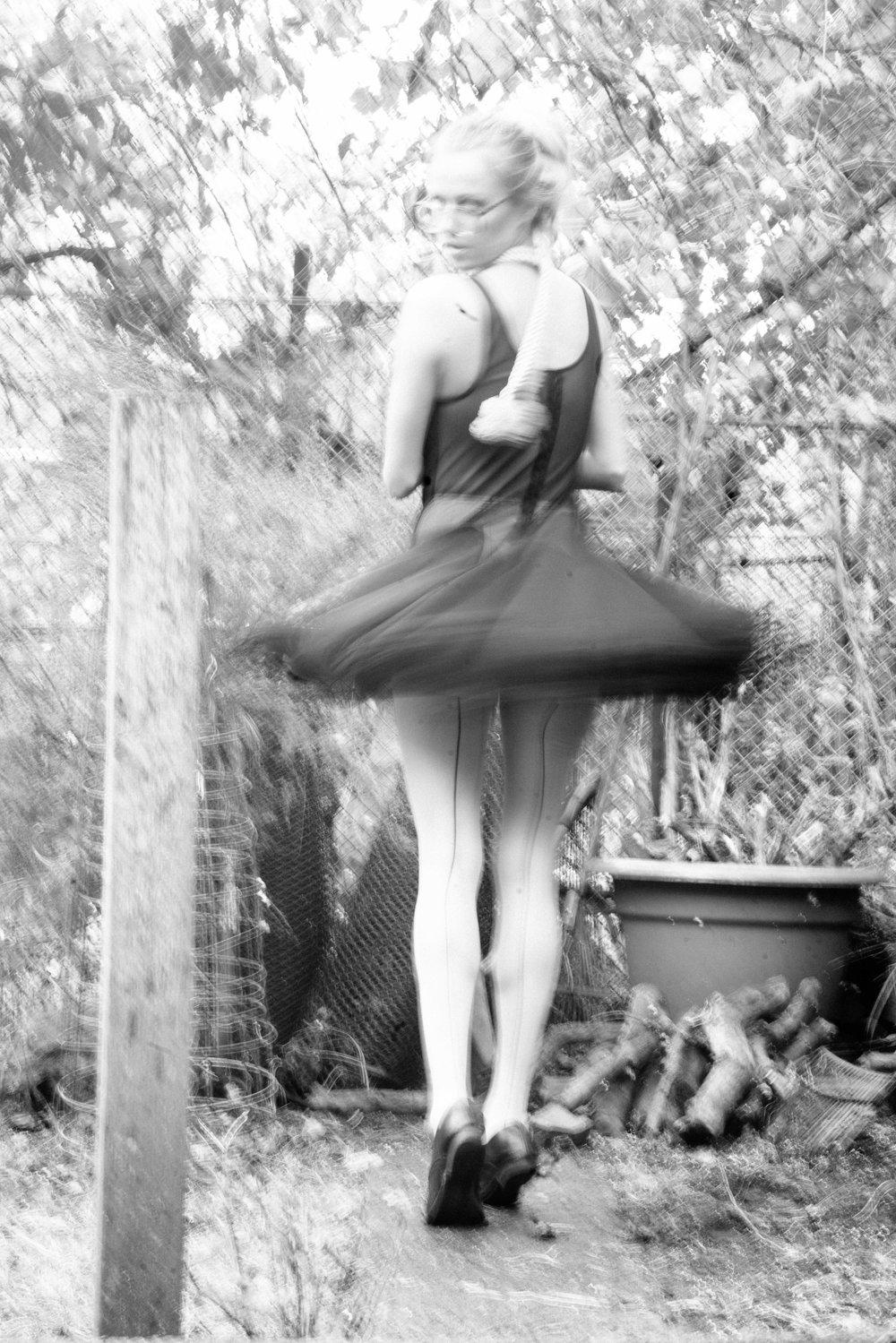 Spencer Ostrander Olga De Mar Kelsey Randall black mesh crinoline skirt godet ruffle hem hook and eye back sheer