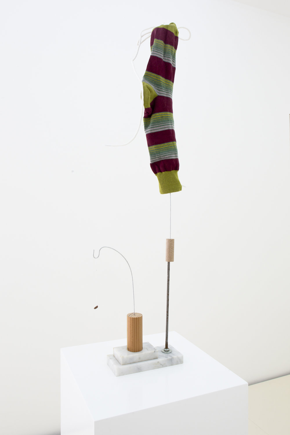 Untitled (Red with green stripes sock), 2016, Cotton sock, shoelace, shoe button, marble, wire, metal, wood, and thread, 78 x 7.5 x 6.5 cm (30.5 x 19 x 2.5 in)