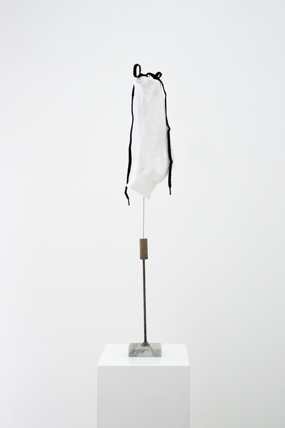 Untitled (White sock), 2016, Cotton sock, shoelace, marble, wire, metal, wood, and thread, 66 x 7.75 x 5 cm (26 x 3 x 2 in)