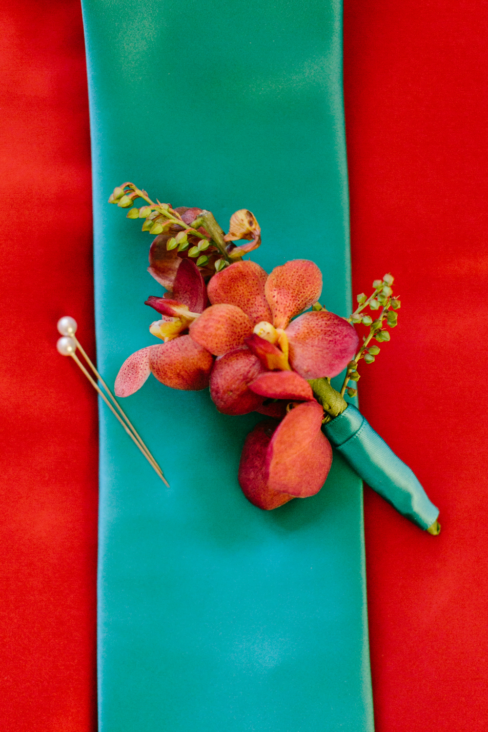 red and turquoise wedding details