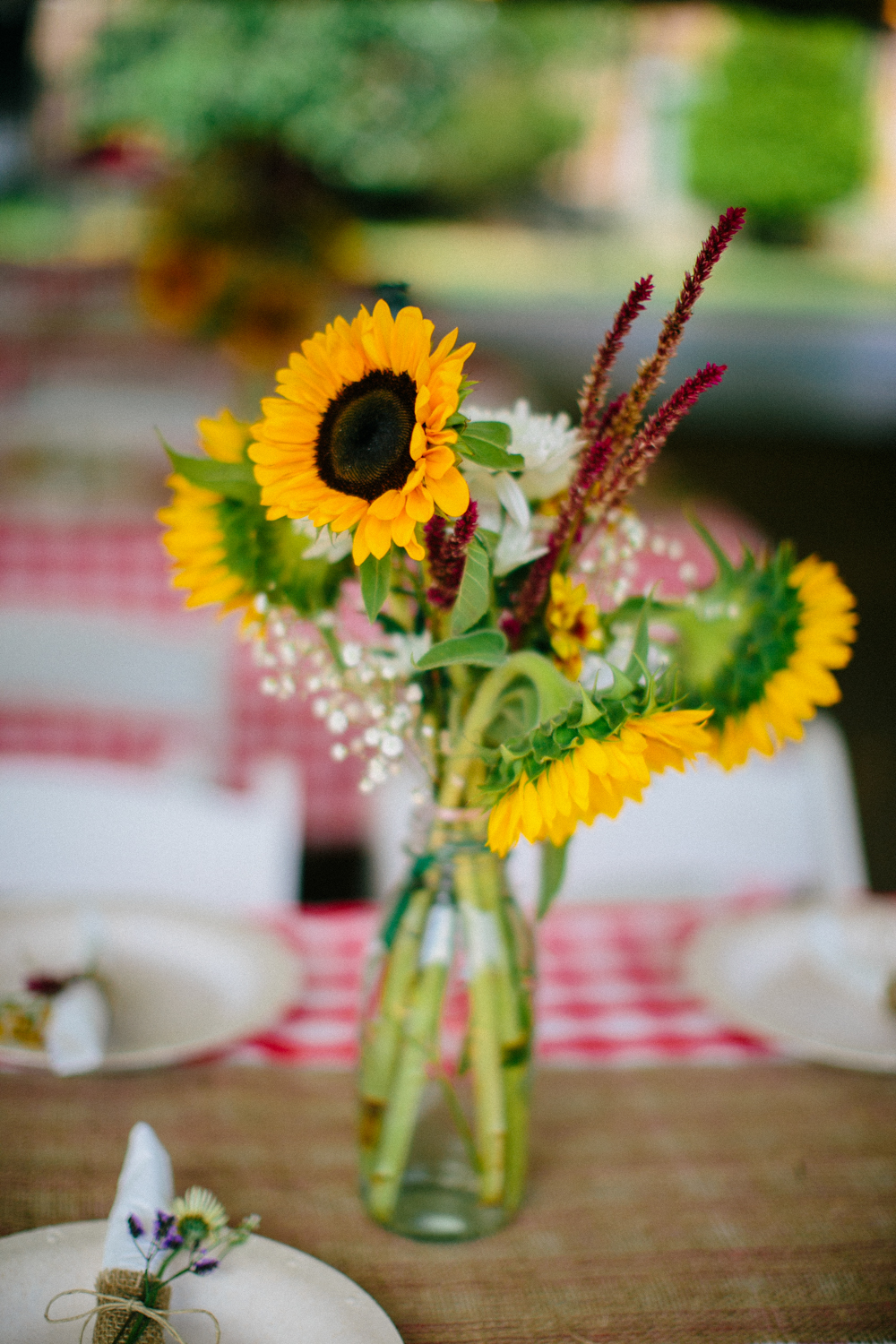 Sunflowers in vases for a backyard wedding