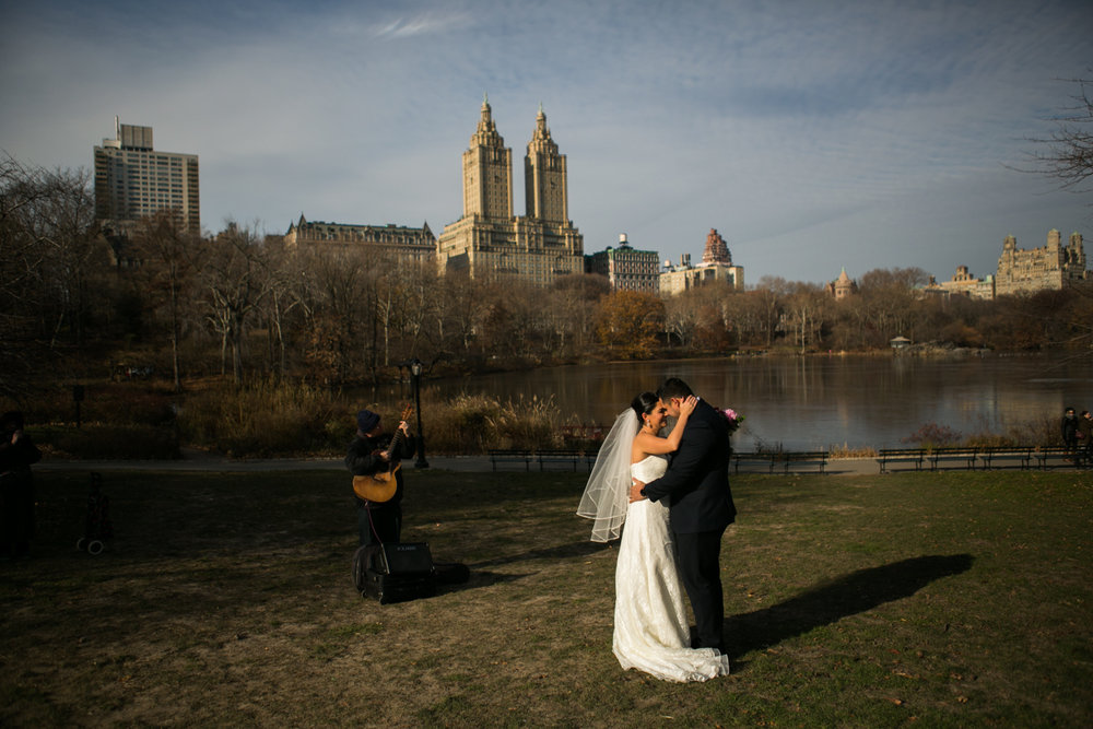Bride and groom share their first dance at their central park wedding