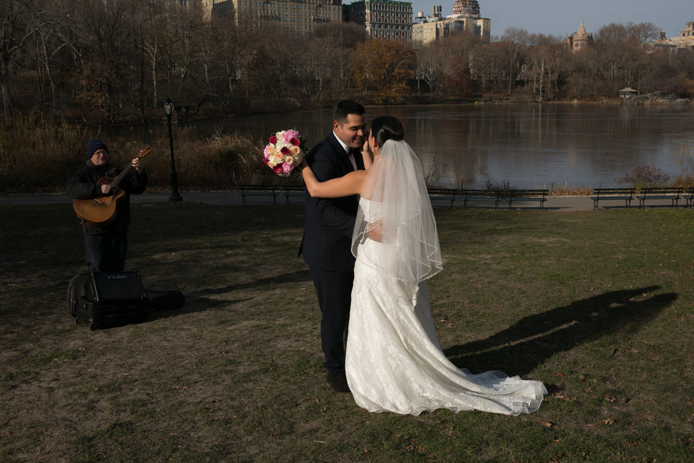 Bride and groom dance together in Central Park