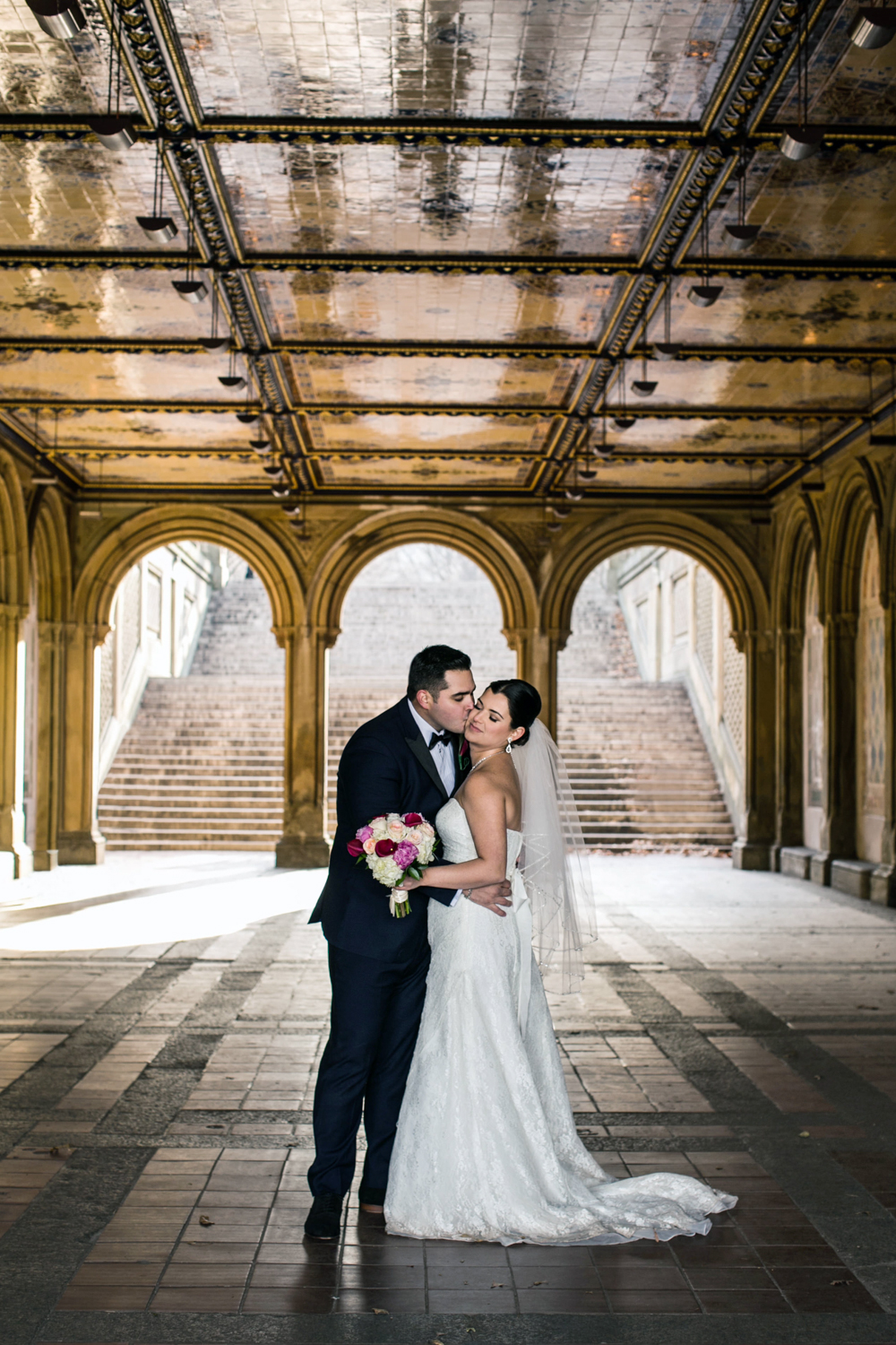 Groom kisses bride during NYC elopement