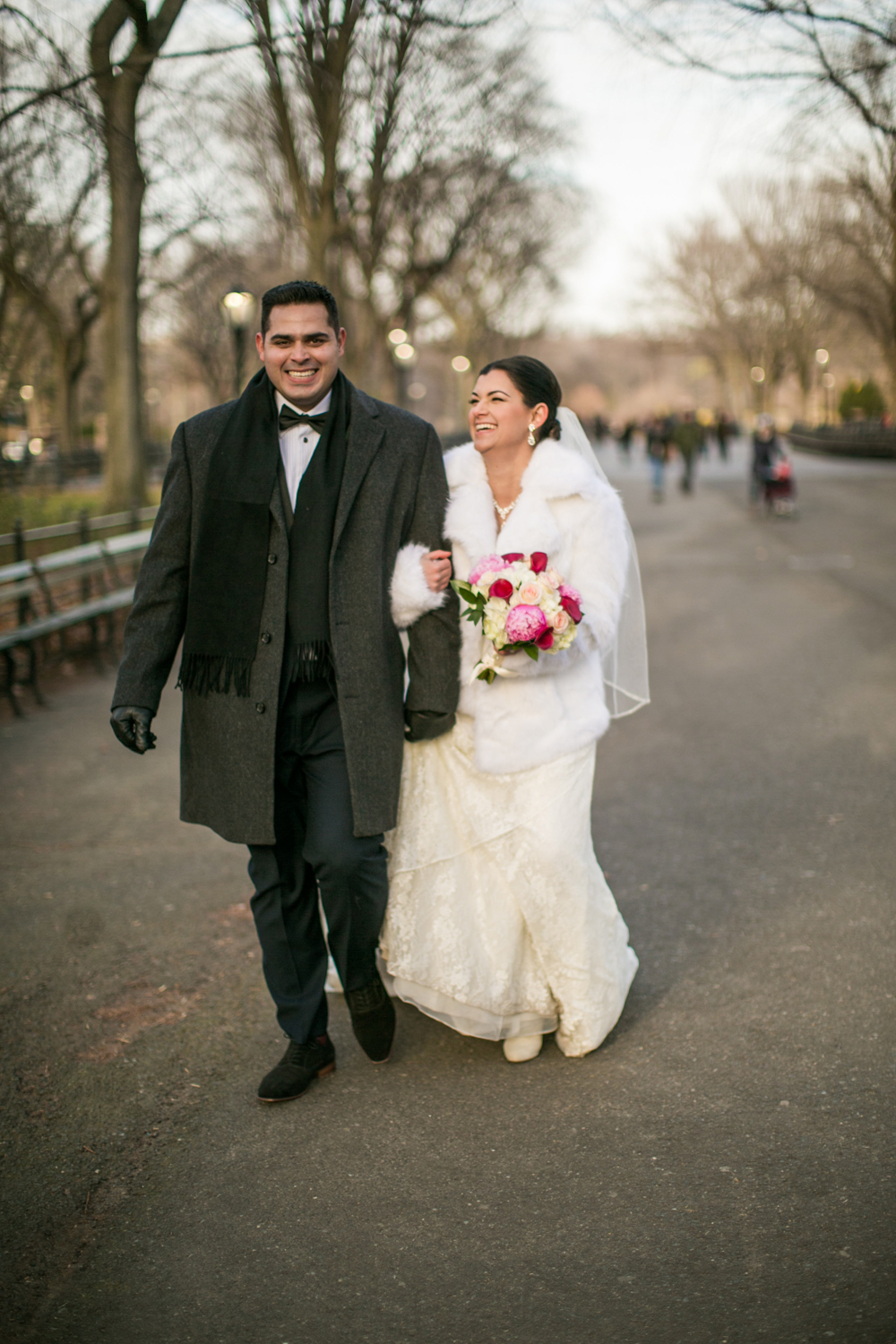 Bride and groom laughing in Central Park