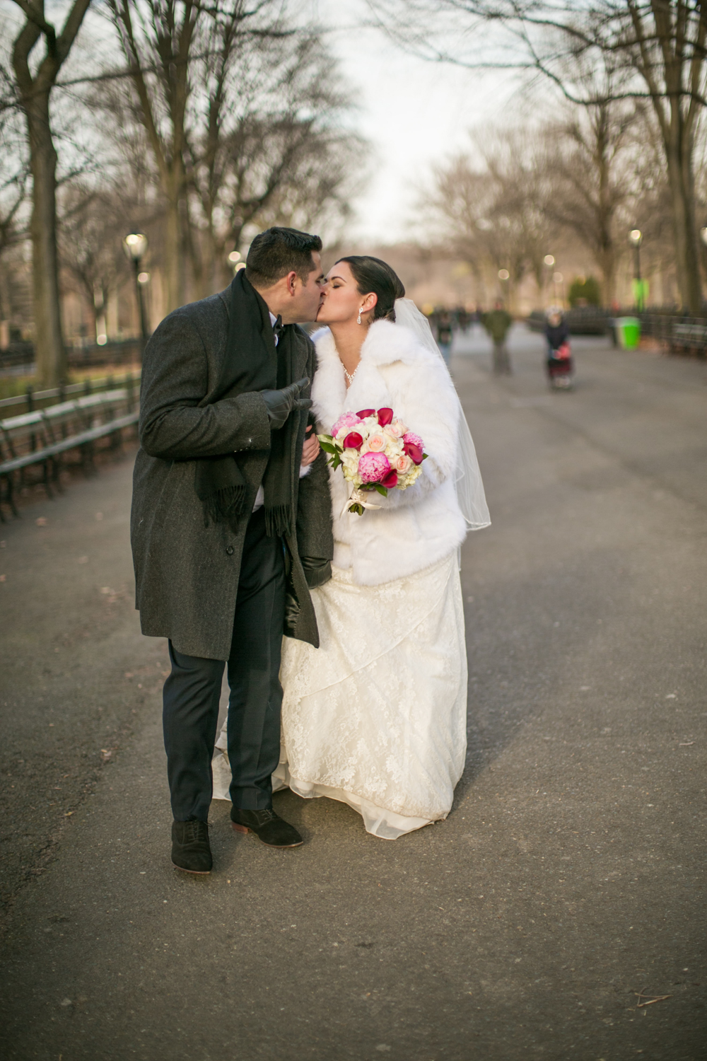 Bride and groom kiss in Central Park