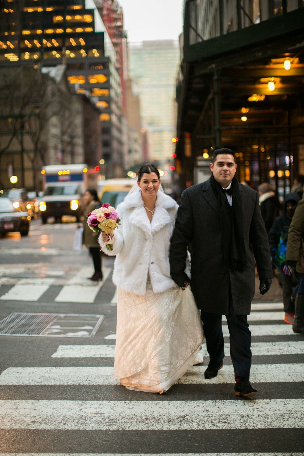 Bride and groom walking through New York City