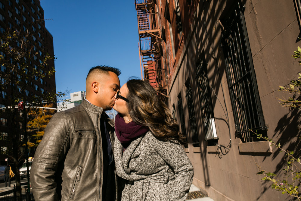 Engaged couple kisses in New York City