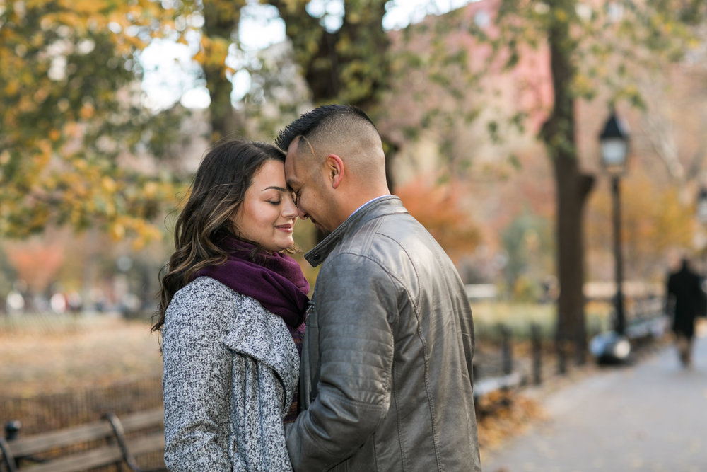 Engaged couple surrounded by NYC fall trees