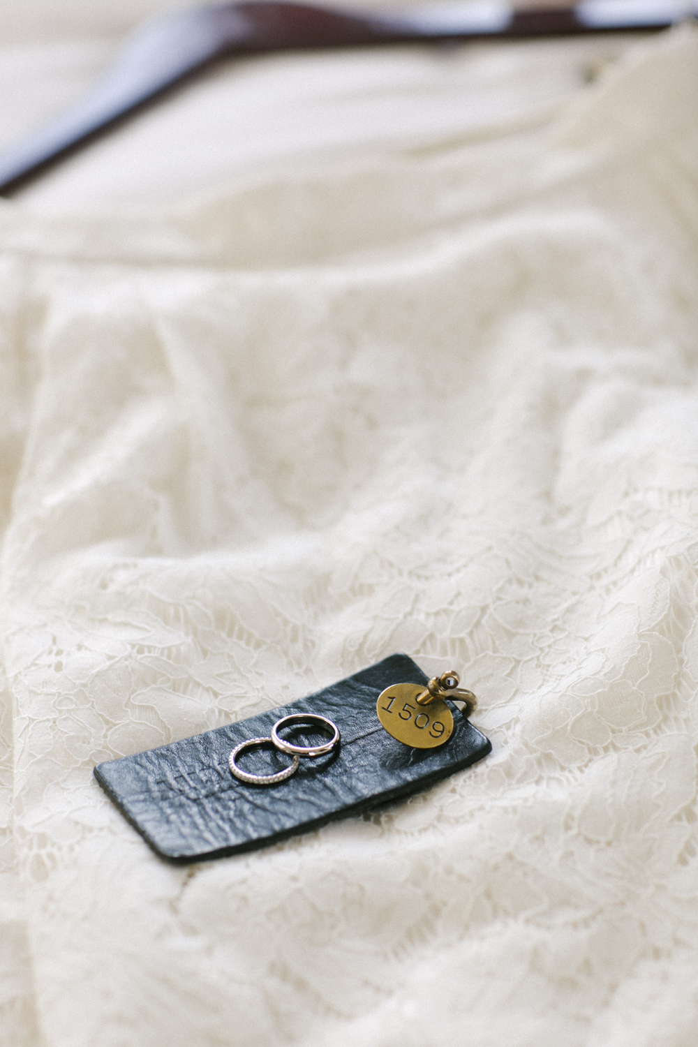 Wedding rings and lace dress detail