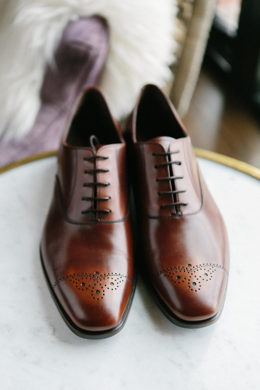 portrait of grooms Prada shoes