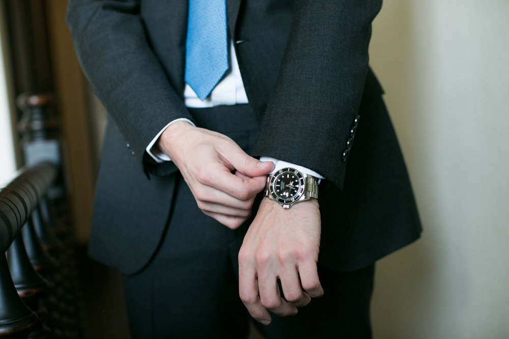 Close up portrait of groom's Rolex watch