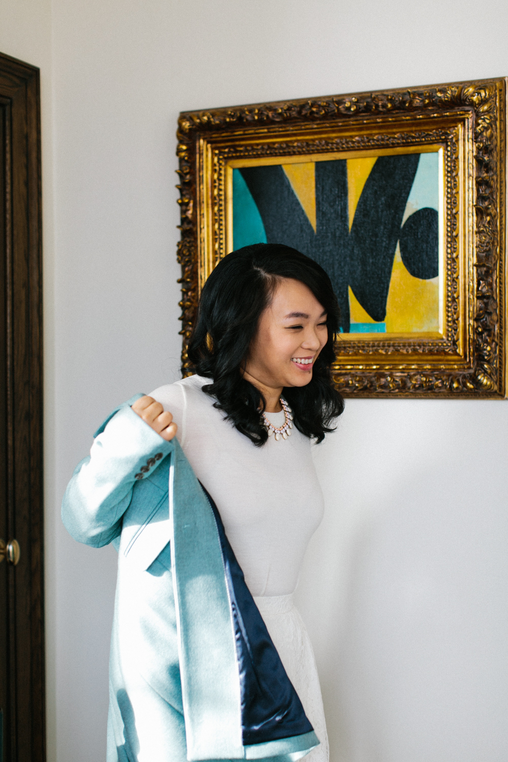 portrait of bride putting on her jacket