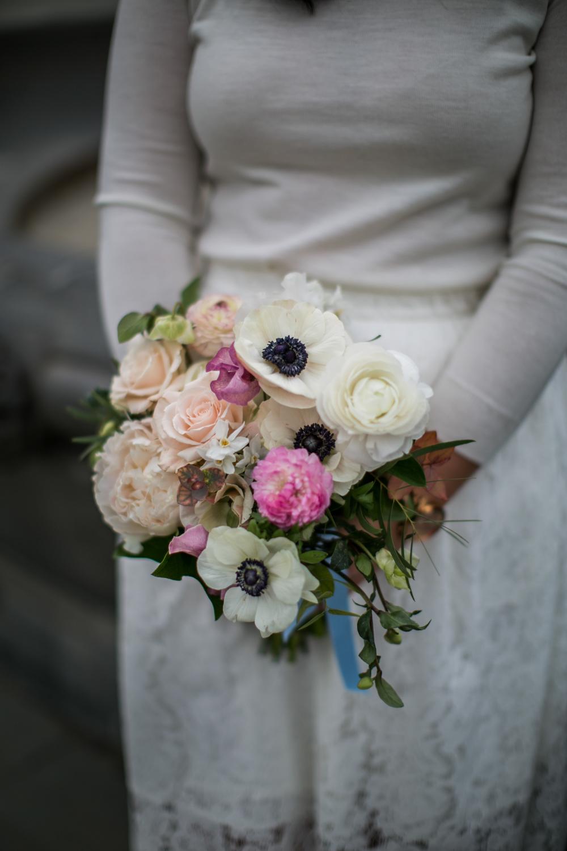 Close up portrait of bride holding bouquet