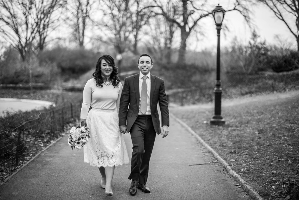 Black and white portrait of bride and groom on walk