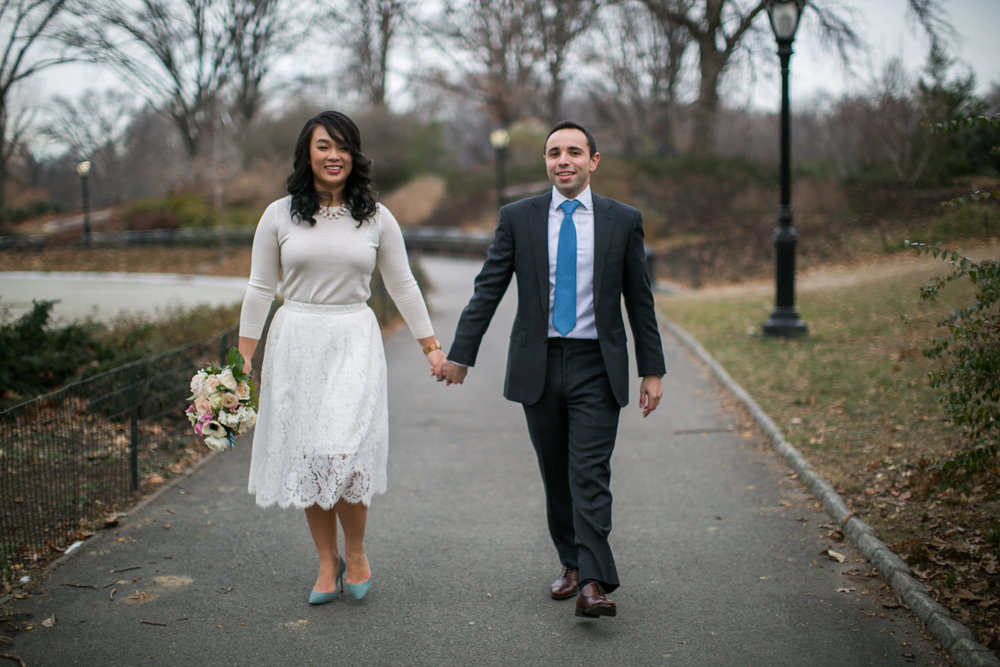 Bride and groom holding hands after elopement