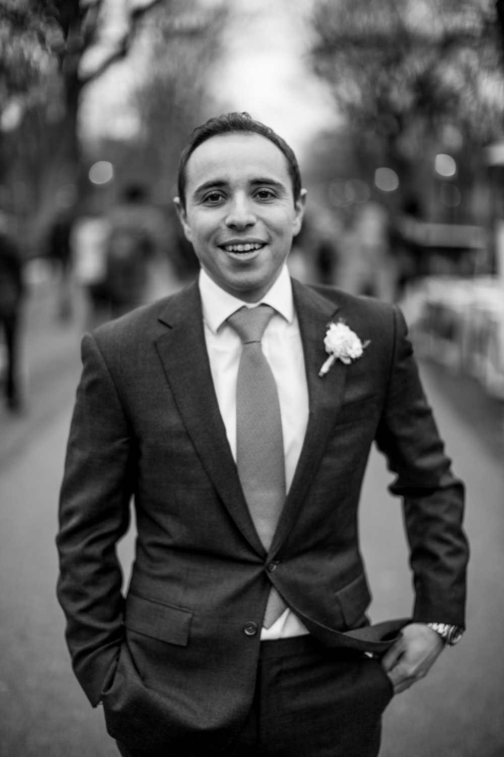 Solo portrait of groom in black and white