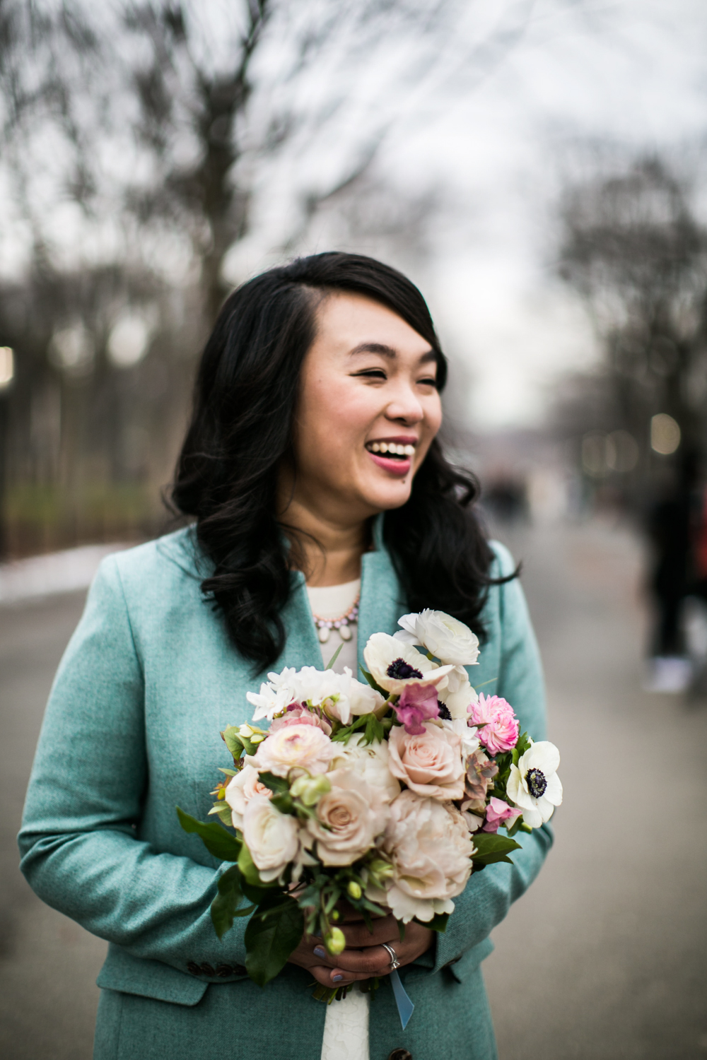 Solo portrait of NYC bride holding her bouquet